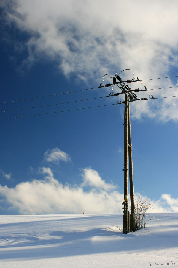 Power pole with blue sky